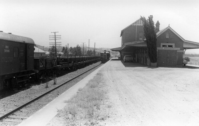 A rail train and diesel railcar sit at the expansive station.