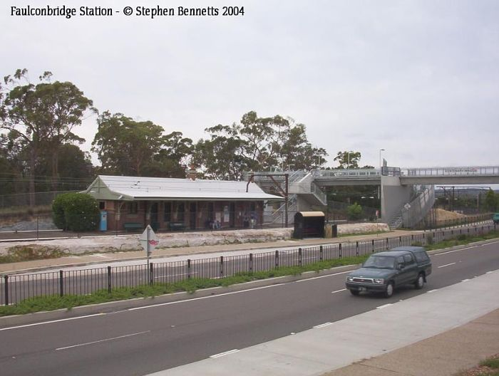 The view looking across the Great Western Highway of the station and footbridge.