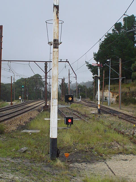A closer view of the signal post with the semaphores replaced by fixed stop lights.