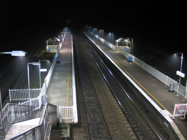A great night-time shot of the station, looking down the line.