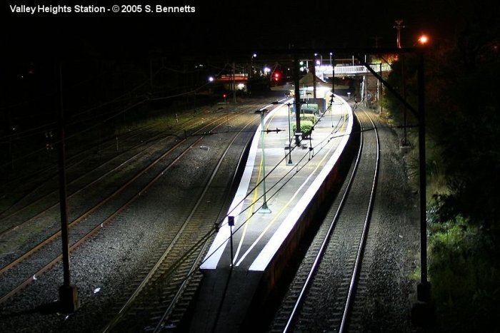 A photo taken after dark from the road bridge at the Sydney end of Valley Heights looking west. Photo shows the shapely island platform with the Up main on the right, the Down main and Down refuge loop and sidings on the left.