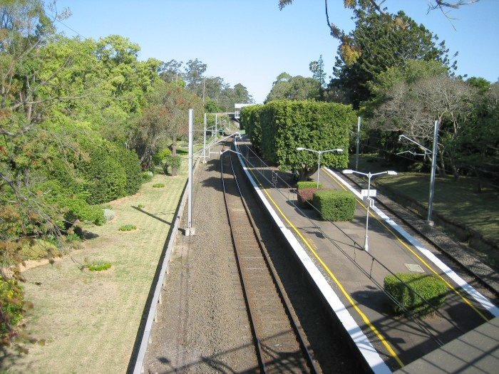 Wahroonga station looking south from a pedestrian overbridge. The well kept gardens are a major feature of the station.